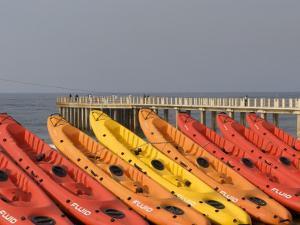 Orange and Red Rental Kayaks on Beach by Pascale Beroujon