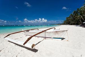 Wooden Boat on Tropical Beach with White Sand by pashapixel