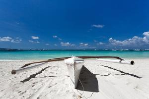 Wooden Boat on Tropical Beach by pashapixel
