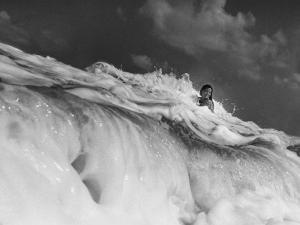 S. Florida, Woman Playing in Surf by Pat Canova