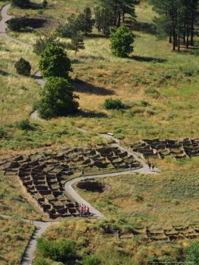 13th Century Tyuonyi Pueblo Ruins by Pat Vasquez-cunningham