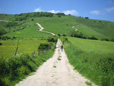 Figure on a Pathway Leading Up a Hill in the South Downs, Near Lewes, Sussex, England, UK