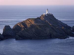 Muckle Flugga and its Lighthouse, Hermaness Nature Reserve, Unst, Shetland Islands, Scotland by Patrick Dieudonne