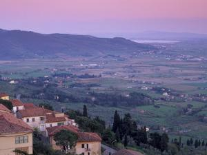 View from the Medieval Town of Cortona Towards Lago Trasimeno, at Sunset, Cortona, Tuscany, Italy by Patrick Dieudonne
