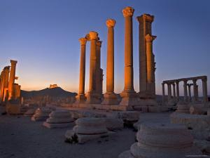 Part of Illuminated Colonnade Ruin with Qala't Ibn Maan on the Hilltop Behind by Patrick Horton