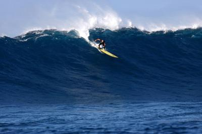 Garrett Mcnamara, Big Wave Surfer, Surfing Down a Wave Face at Jaws