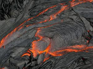 Molten Magma Glows under a Dark Crust of Hardened Lava by Patrick McFeeley