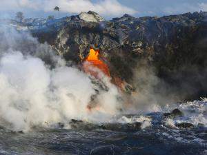 Steam Rises as Lava Flows into the Sea from a Lava Tube by Patrick McFeeley