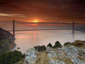 Golden Gate Bridge at Sunset under Foggy and Cloudy Skies, San Francisco Bay, California, USA by Patrick Smith