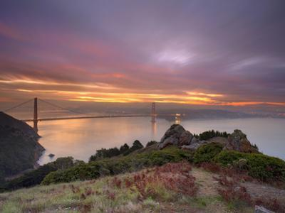 Golden Gate Bridge at Sunset under Foggy and Cloudy Skies, San Francisco Bay, California, USA