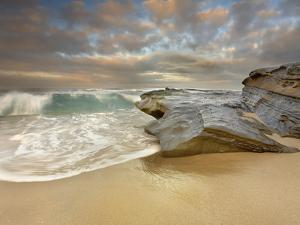 Large Waves Eroding the Sandy Beach and Sandstone Outcrop on the La Jolla, California, USA Shore by Patrick Smith