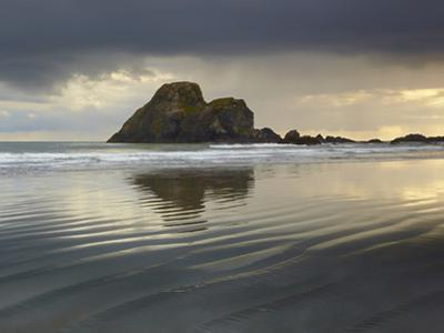 Low Tide at Sunset on a Flat Beach with Camel Rock Near Trinidad, Northern California, USA