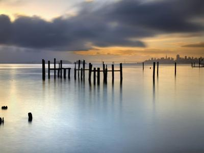 San Francisco and San Francisco Bay at Sunrise, with Old Pier Pilings under Cloudy Skies