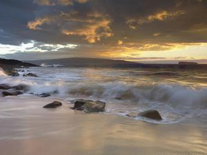 Sunset Light on Waves Crashing onto a Beach, with Molokini and Kaho`Olawe Islands in the Background by Patrick Smith