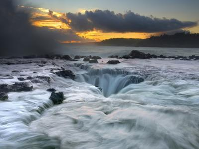 Waves Moving Over, Around, and into a Blowhole on the North Shore of Kauai at Sunrise