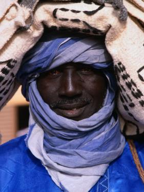 Close Up of a Tuareg Carpet Seller in Traditional Indigo Clothing, Timbuktu, Mali by Patrick Syder