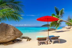 Tropical Beach Scenery with Deck Chairs in Thailand by Patryk Kosmider