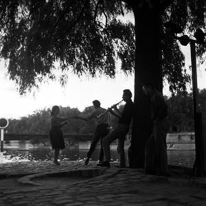 Rock 'n' Roll Dancers on the Square du Vert-Galant, Paris, 1960 by Paul Almasy