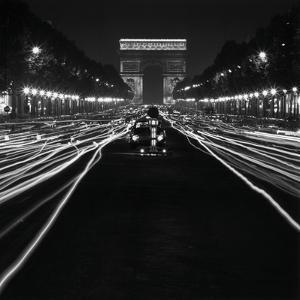 Street Scene at Night, 1950 by Paul Almasy