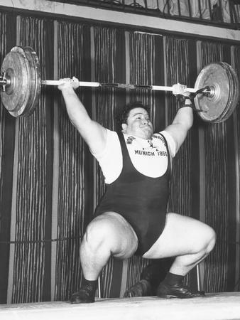 https://imgc.allpostersimages.com/img/posters/paul-anderson-lifts-320-pounds-during-the-1955-weightlifting-world-championships-at-munich_u-L-Q10WWG90.jpg?p=0