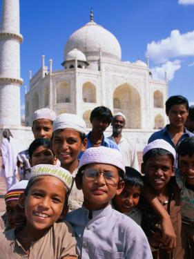 Group of Boys with Taj Mahal in Background, Looking at Camera, Agra, India by Paul Beinssen