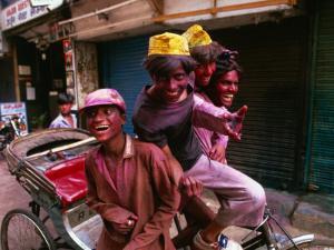Group on Rickshaw Celebrating Holi Festival, Delhi, India by Paul Beinssen