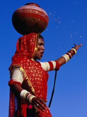Performer Dancing with Water Pot at Holi Festivities, Jaipur, India by Paul Beinssen