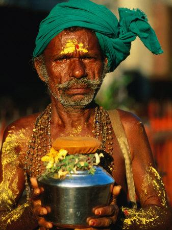Pilgrim with Offerings to Give to Deities at Sri Meenakshi Temple, Madurai, India
