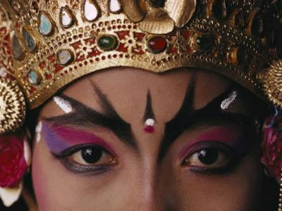 A Close View of a Face of a Balinese Dancer in Costume and Makeup by Paul Chesley