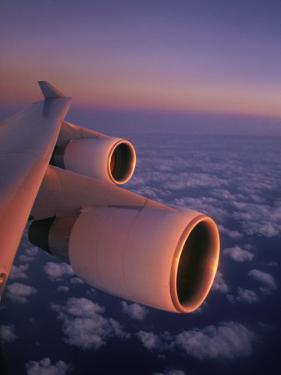 A Close View of the Wing and Jet Engines of a Plane in Flight by Paul Chesley