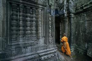 A Monk Explores the Ancient Ruins of the Angkor Wat Temple Complex by Paul Chesley