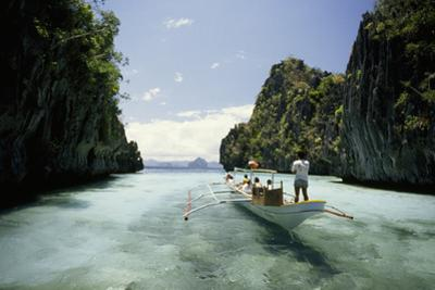 A Tourist Boat Travels Through the Islands of the El Nido Area by Paul Chesley