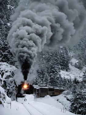 A Train Chugs Through the Snow Blanketing the San Juan Mountains by Paul Chesley