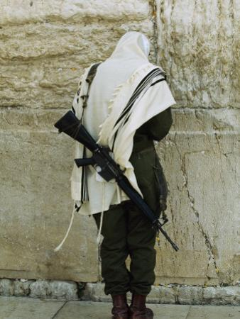 Israeli Soldier with Rifle Praying at the Wailing Wall by Paul Chesley