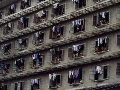 Laundry Drying Outside Apartments Window Where People are Cooling Off by Paul Chesley