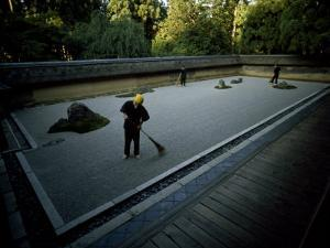 Men Rake the Famous Rock Garden at the Zen Ryoanji Temple by Paul Chesley
