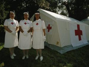Nurses Stand Ready to Lend Aid at a Horse Jumping Event in Rome by Paul Chesley