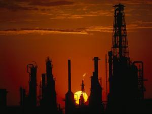 Oil Refinery Silhouetted During a Dramatic Sunset by Paul Chesley