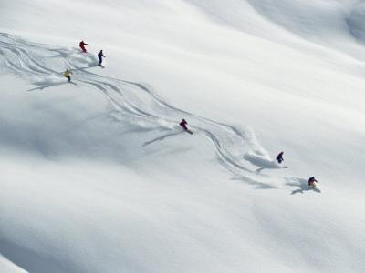 Six Skiers Make Their Way Down a Snow-Covered Hill by Paul Chesley