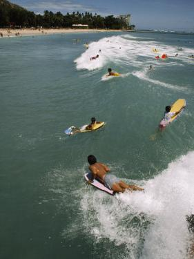 Swimmers on Boogie Boards in the Gentle Surf of Waikiki by Paul Chesley