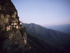 Tigers Den, a Buddhist Monastery, Clings to a Cliff in Bhutan by Paul Chesley