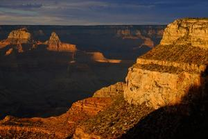 A View from the South Rim of Sunlight Striking Cliffs in the Grand Canyon by Paul Damien