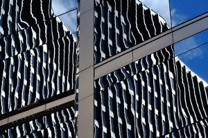 An Abstract Pattern of Windows, Glass and Reflections in Downtown Chicago, Illinois by Paul Damien