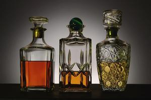 Glass and Crystal Decanters Containing Brandy and Whiskey by Paul Damien