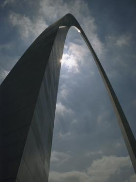 Skyward View of the Gateway Arch Against a Cloud-Filled Sky by Paul Damien