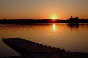 Sunset over the Shore of Eva Lake in Ontario, Canada by Paul Damien