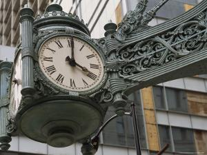 The Marshall Field Clock on the Corner of State and Randolf Streets by Paul Damien