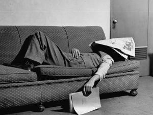 Writer Niven Busch Lying on Sofa with Newspaper over His Face as He Takes Nap from Screenwriting by Paul Dorsey