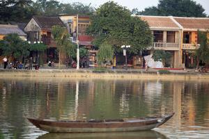 Looking across the Thu Bon River to the ancient town of Hoi An, Vietnam by Paul Dymond