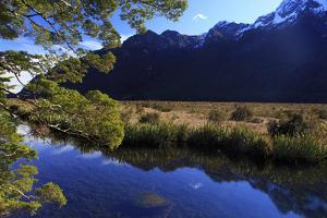 Mirror Lakes Reflect the Surrounding Snow Covered Mountains , the South Island of New Zealand by Paul Dymond